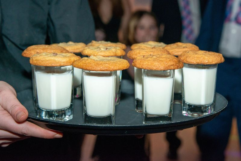 Bat-Mitzvah, tray of small glasses of milk with a freshly-baked chocolate chip cookie on top of each glass