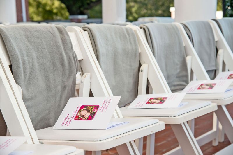 Bat-Mitzvah with cool, classy theme - outdoor seating lined up with programs on the seats