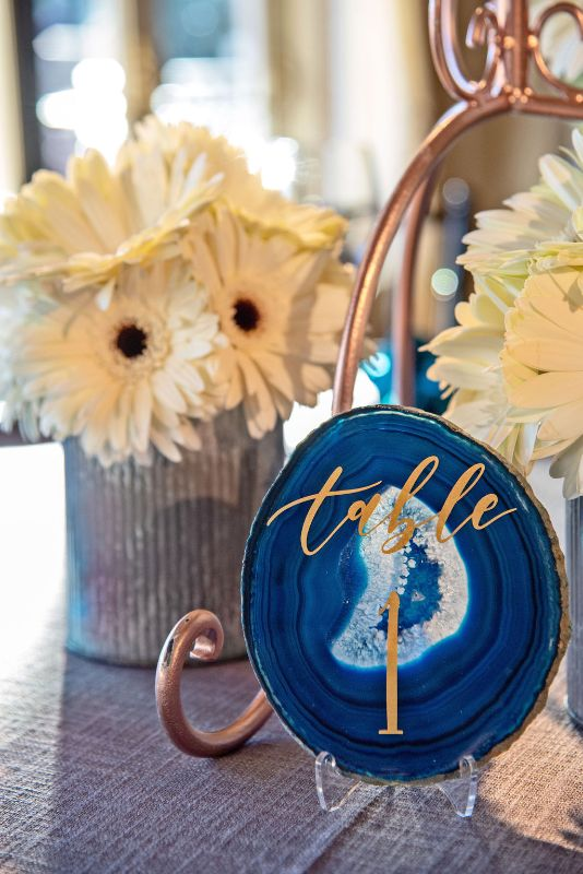 Bat-Mitzvah with cool, classy theme - cream-colored daisy centerpieces