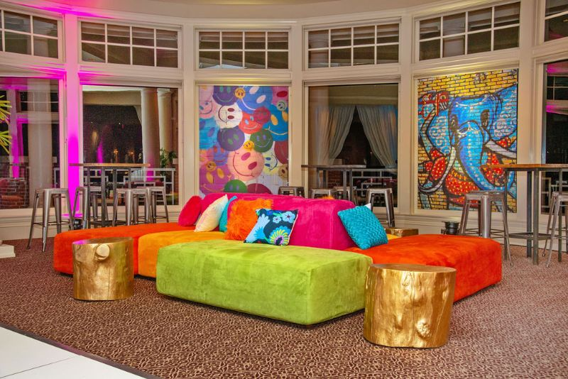 Bat-mitzvah, colorful theme - brightly colored seating area with couches and murals