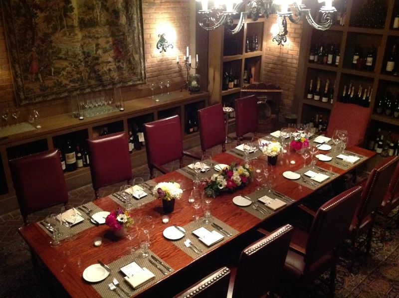 Long table set up for corporate event in wine cellar