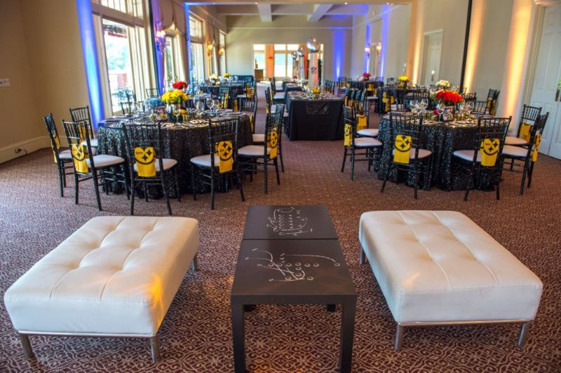 Bar Mitzvah, football theme, shot of whole room with tables set, seating area