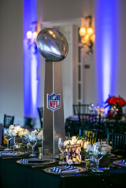 Bar Mitzvah, football theme, shot of tables with NFL trophy