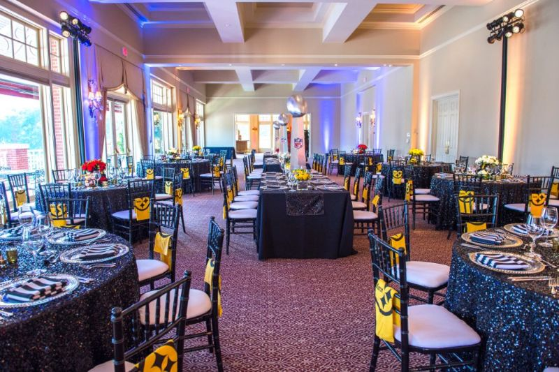 Bar Mitzvah, football theme, shot of whole room with tables set for guests