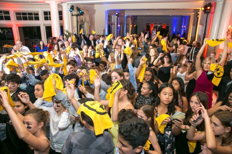 Bar Mitzvah, football theme, kids gathered on dance floor