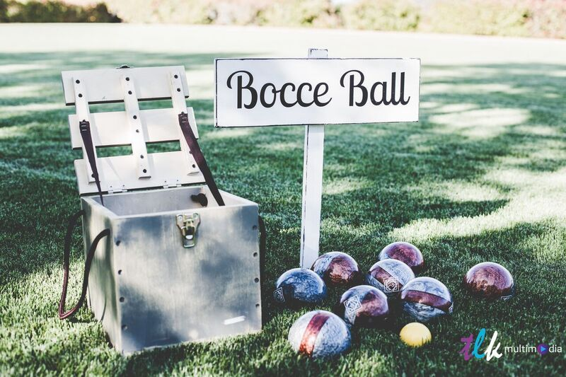 Green lawn set up for outdoor event with Bocce Ball set up