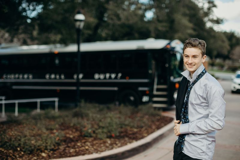 Call of Duty-themed Bar Mitzvah, smiling young man with bus in background
