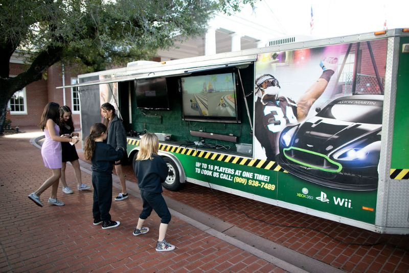 Call of Duty-themed Bar Mitzvah, kids playing on mobile gaming unit