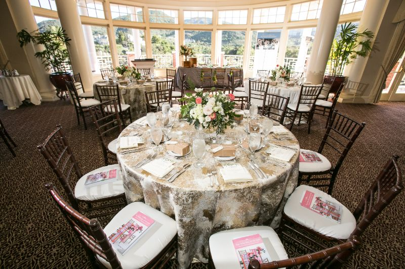 Indoor venue decorated with tables set for guests