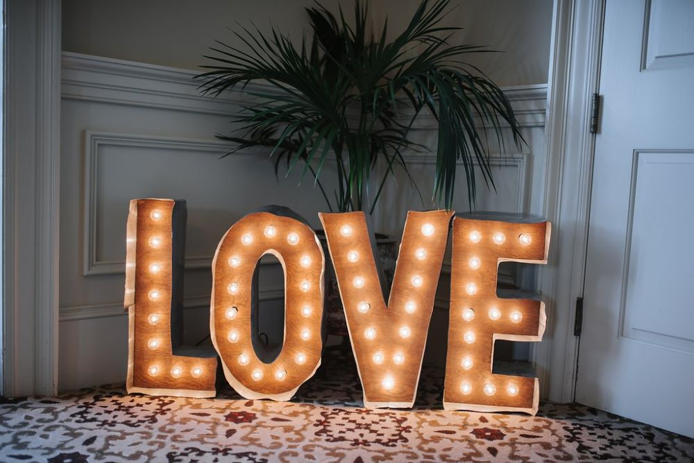 sign the reads love with light bulbs