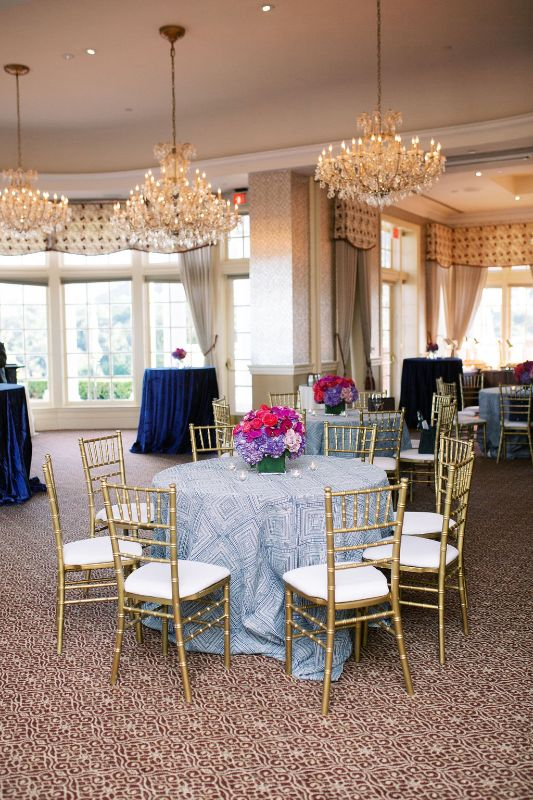 Indoor venue with tables set for corporate event