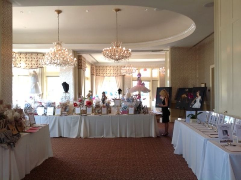 Room with auction tables set up for corporate fundraiser
