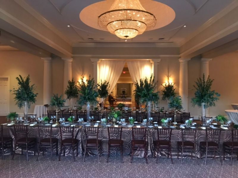 Indoor venue with long tables set for guests