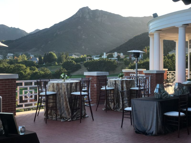 Special event venue, outdoor terrace with tall tables and view of mountains