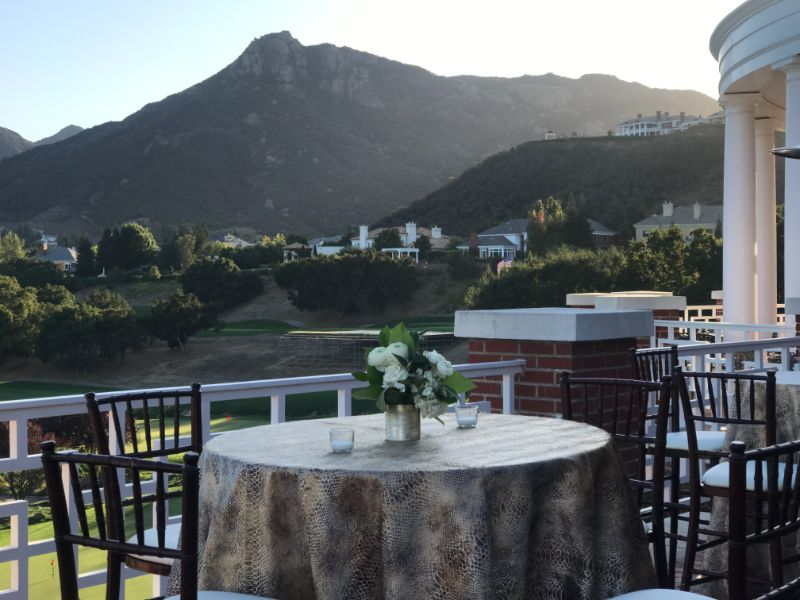 Special event venue, outdoor terrace with up-close of tall table and view of mountains