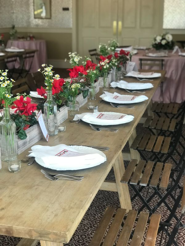 Indoor venue for wedding shower with tables set for guests