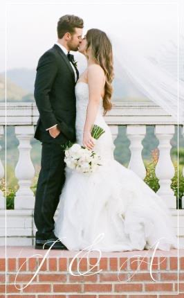 Real Wedding-J&A Kissing with mountains in back ground