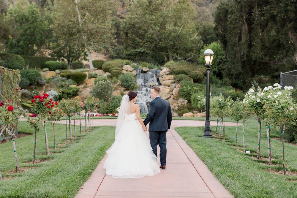 Real Wedding-M&B walking hand in hand towards waterfall