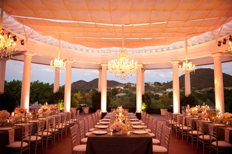 Outdoor venue with 3 long tables set for guests