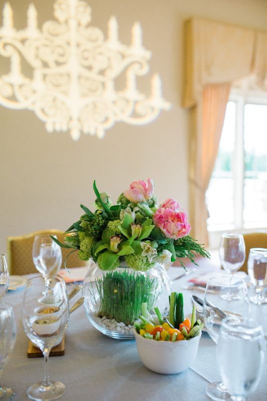 Flower centerpiece with crudités set out