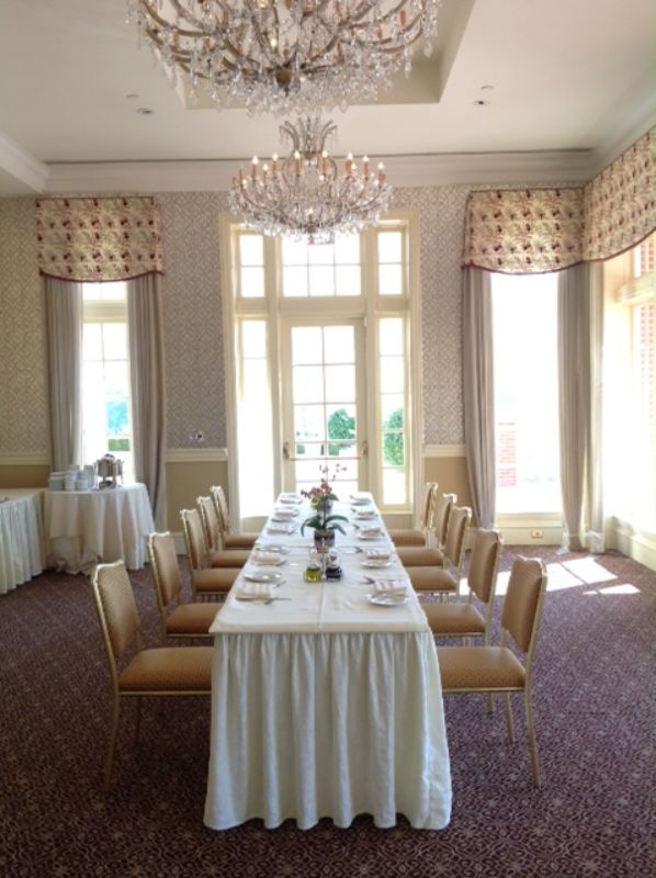 Long table set up for guest at corporate event