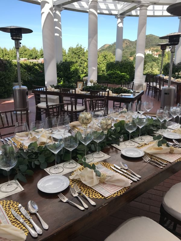 Long tables set up outdoors for corporate event