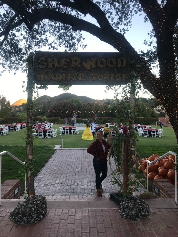 Sherwood Forest sign, with tables set up in background for special event
