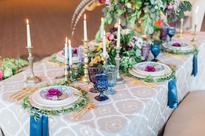 Styled photo-shoot with up-close view of table settings and flowers for special occasion