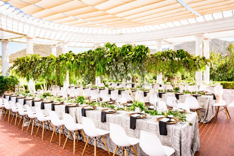 Outdoor venue with long tables set for guests