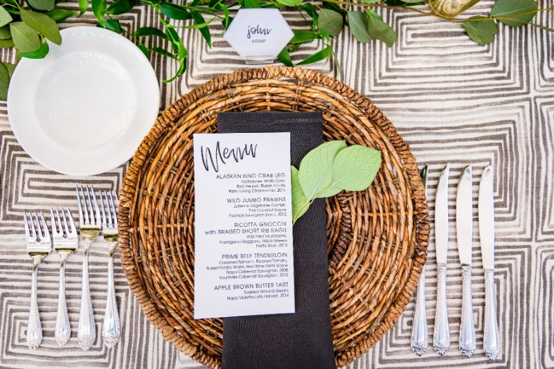 Close up of place setting, with name tag and menu
