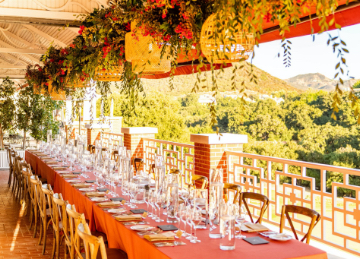 Additional Special long rectangular table orange tablecloth.